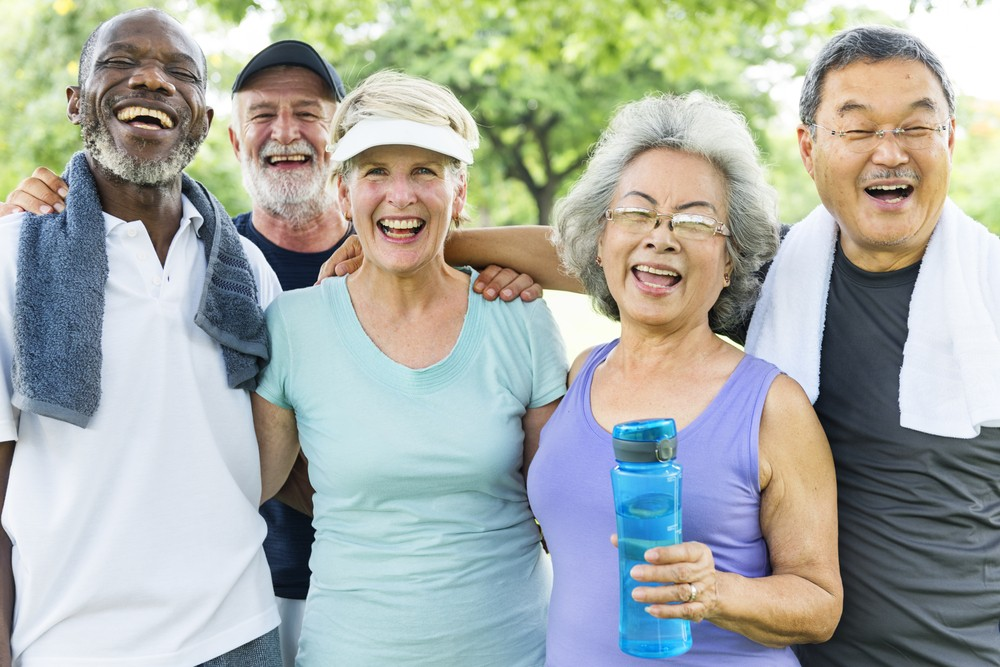 Senior Group Friends Exercise Relax Concept - 5 Benefits of Living in a 55+ Community